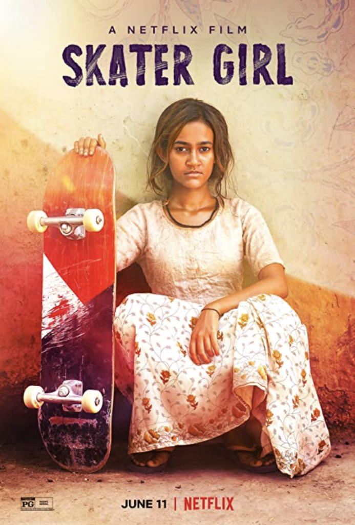 Still of the film Skater Girl, young Indian girl holding a skateboard and looking at the viewer